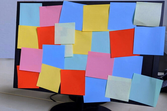 Colorful post-its stuck on a computer screen
